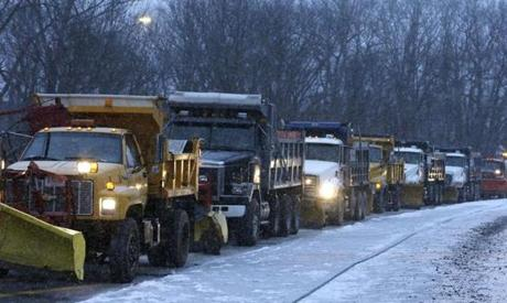 Trucks with snowplows lined up on a ramp near Interstate 95 in Weston during a snowstorm last month.